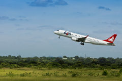 LAM Airlines, Embraer 190 Jet, Takeoff. Stakeholders brainstorm on Africa's aviation problems facing the sector with a view to helping the continent find Stock Photo