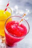 Lama congelada Granitas do fruto com palhas bebendo Foto de Stock