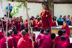 Lama debating Buddhist scriptures Royalty Free Stock Photo