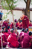 Lama debating Buddhist scriptures Stock Photography