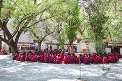 Lama debating Buddhist scriptures Stock Photos