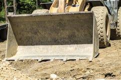 Lama del bulldozer sulla terra Immagine Stock Libera da Diritti