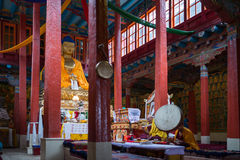 Lama praying in Hemis gompa Stock Photos