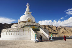 Lama Tibetan walk around the Shanti Stupa Royalty Free Stock Photo