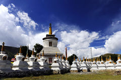Lamaist Pagodas. Around the platforms are dozens of white pagodas, each containing a statue of the Tibetan Buddha Royalty Free Stock Photography