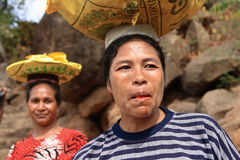 Lamalera woman carrying goods Royalty Free Stock Image