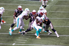 Lamar Miller stopped by Patriots Defense Royalty Free Stock Images
