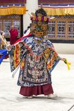 Buddhist lamas dressed in mystical mask dancing Tsam mystery dance in time of Yuru Kabgyat Buddhist festival at Lamayuru Gompa, La. LAMAYURU, INDIA - JUNE 13 Royalty Free Stock Photography