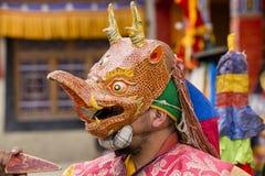 Buddhist lamas dressed in mystical mask dancing Tsam mystery dance in time of Yuru Kabgyat Buddhist festival at Lamayuru Gompa, La. LAMAYURU, INDIA - JUNE 13 Stock Photos
