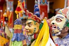 Buddhist lamas dressed in mystical mask dancing Tsam mystery dance in time of Yuru Kabgyat Buddhist festival at Lamayuru Gompa, La. LAMAYURU, INDIA - JUNE 13 Royalty Free Stock Image