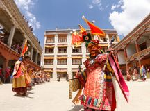 Monks perform a religious masked and costumed mystery dance of Tibetan Buddhism at the traditional Cham Dance Festival royalty free stock image