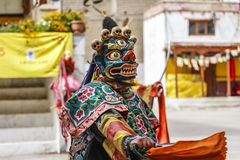 LAMAYURU, INDIA - SETEMBER 13, 2015: An unidentified buddhist lamas dressed in mystical mask dancing Tsam mystery dance in time of Royalty Free Stock Images