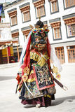 LAMAYURU, INDIA - SETEMBER 13, 2015: An unidentified buddhist lamas dressed in mystical mask dancing Tsam mystery dance in time of Stock Photo