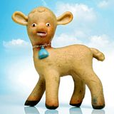 Lamb. Toy baby lamb against cloudy sky Royalty Free Stock Photo