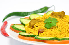 Lamb Biryani. Biryani, biriani, or beriani is a set of rice-based foods made with spices, rice (usually basmati) and meat, fish, eggs or vegetables stock image