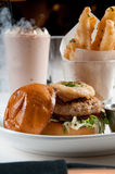Lamb burger with yucca fries. And mayonnaise Stock Photos