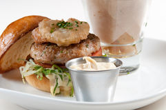 Lamb burger with yucca fries Stock Photos