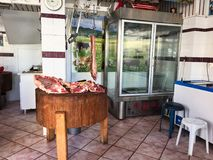 Meat Carcasses in Old Style Butcher Shop, Greece. Lamb carcasses in an old style butcher shop where meat is cut to order, not pre-cut and wrapped in plastic royalty free stock image
