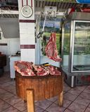 Meat Carcasses in Old Style Butcher Shop, Greece. Lamb carcasses in an old style butcher shop where meat is cut to order, not pre-cut and wrapped in plastic stock photo