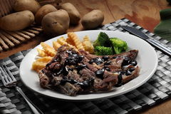 Lamb chop. With black pepper sauce royalty free stock photo