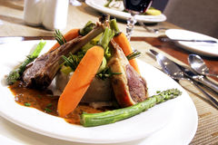 Lamb Chop and Carrot Formal Dinner. Lamb Chop with vegetables at formal dinning table Royalty Free Stock Image