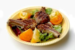 Lamb Chop Dinner. Lamb Chops on a bed of lettuce with sliced tomatoes Royalty Free Stock Photo