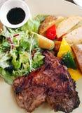 Lamb chop, potato & salad Stock Photography