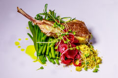 Lamb chop served with green beans stock photo