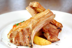 Lamb chops. With potato wedges royalty free stock photo