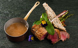 Lamb chops. With mint souce stock photography