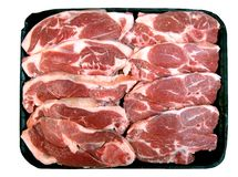 Lamb Chops. A photo of a few raw lamb chops stacked together royalty free stock photos