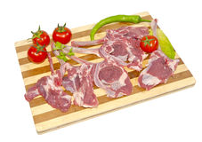 Lamb chops. On wooden board Stock Photos