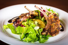 Lamb chops. With mashed potatoes and a little salad stock image