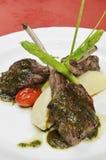 Lamb chops. Intaly Lamb chops on white dish stock images