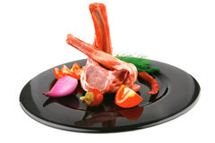 Lamb chops on black Royalty Free Stock Image