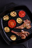 Lamb chops on the bone with vegetables. Lamb chops on the bone with grilled vegetables stock photos