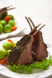 Lamb chops with brussel sprouts and carrots Royalty Free Stock Photography