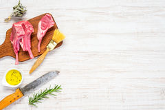 Lamb Chops, Butcher Knife and Spices on Copy Space Royalty Free Stock Photo