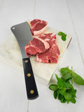 Lamb chops with fresh mint and  meat cleaver Royalty Free Stock Photography