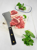 Lamb chops with fresh mint spices and  meat cleaver Royalty Free Stock Images