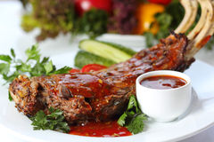 Lamb chops with greens and garnish Stock Images