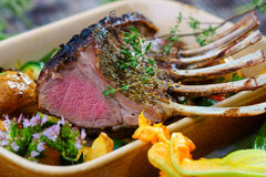 Lamb chops. Grilled Rack of Lamb chops with potatoes and vegetables Stock Photo