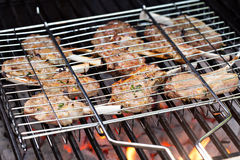 Lamb chops in grilling basket on grill Royalty Free Stock Image