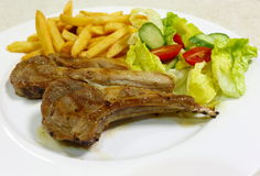 Lamb chops meal side view Stock Images