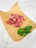 Lamb chops with mint on brown paper Royalty Free Stock Image