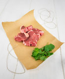 Lamb chops with mint on brown paper Royalty Free Stock Photos