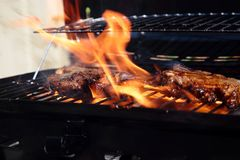 Lamb chops with mint marinade cooking on a barbecue Royalty Free Stock Photo