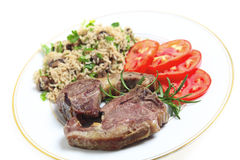 Lamb chops with mushroom rice Royalty Free Stock Photo