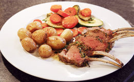 Lamb chops with potatoes and vegetables Royalty Free Stock Image