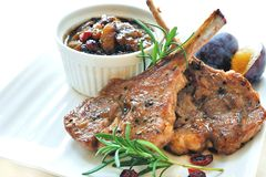 Lamb Chops with Prune Chutney. Rosemary lamb chops with prune, shallot and cranberry chutney Royalty Free Stock Photography